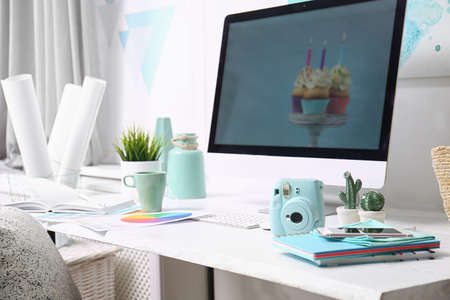 Comfortable designer's workplace with computer and digital camera in studio Stock fotó