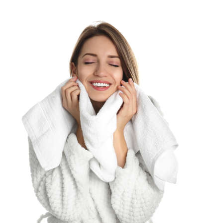 Young woman wiping face with towel on white background Reklamní fotografie