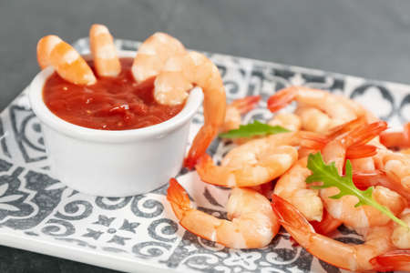 Delicious shrimp cocktail with tomato sauce, closeup