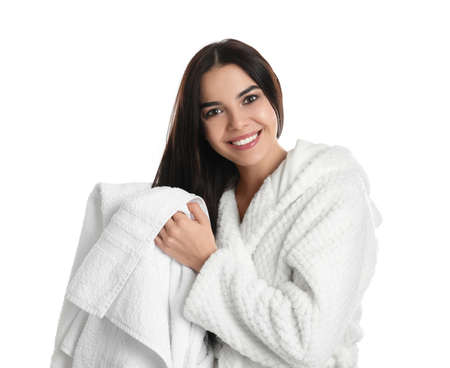 Young woman drying hair with towel on white background