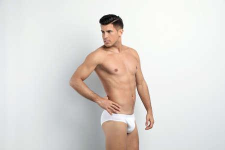 Handsome man in underwear on white background Zdjęcie Seryjne