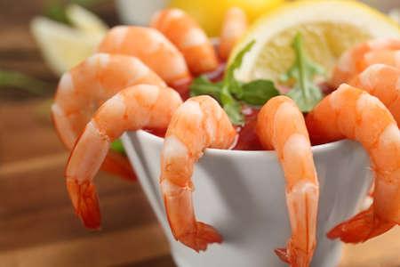 Delicious shrimp cocktail with tomato sauce, closeup Stock fotó