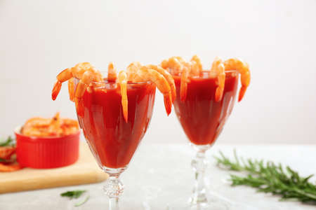 Delicious shrimp cocktail with tomato sauce served on table