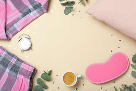 Flat lay composition with sleeping mask on yellow background, space for text. Bedtime accessories