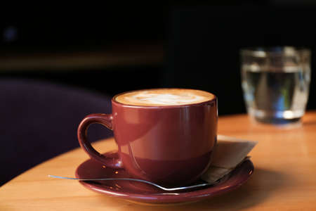 Aromatic coffee on wooden table in cafe Stock Photo