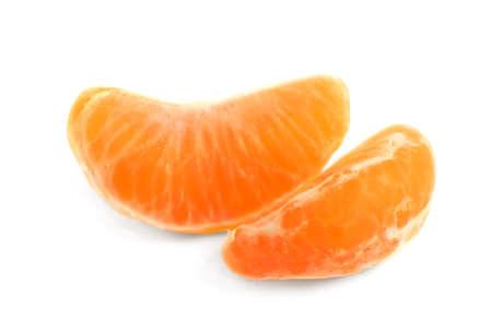 Fresh juicy tangerine segments isolated on white Stock Photo