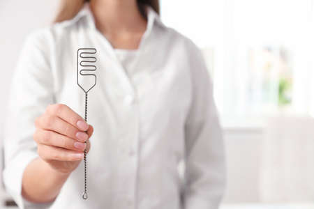 Speech therapist with logopedic probe in clinic, closeup. Space for text