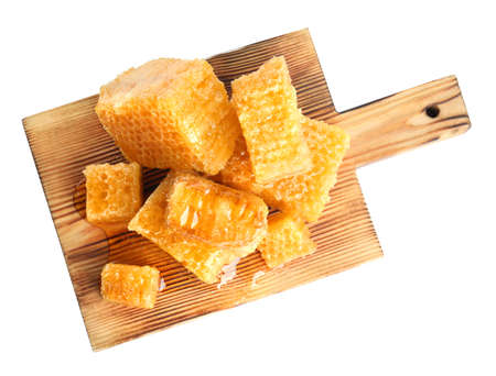 Board with fresh honeycombs isolated on white, top view