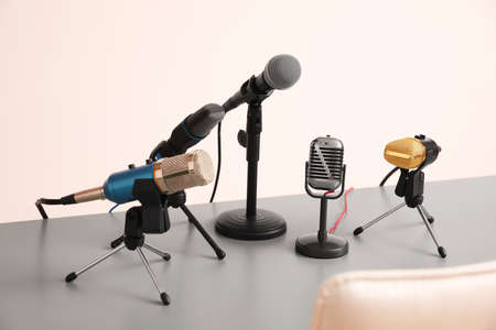 Microphones on light grey table in conference hall. Journalist's work