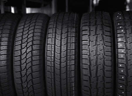 Black car tires in service store, closeup