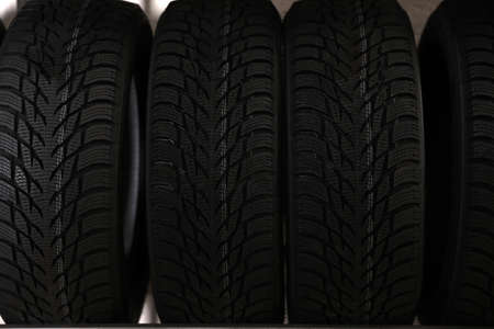 Car tires in auto store, closeup view