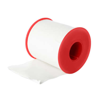 Medical sticking plaster roll isolated on white