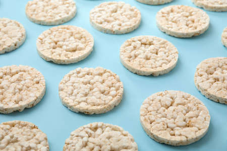 Puffed rice cakes on light blue background