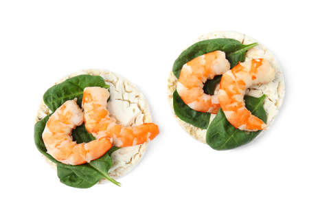 Puffed rice cakes with shrimps and basil isolated on white, top view