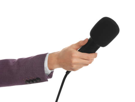 Professional journalist with microphone on white background, closeup Stok Fotoğraf