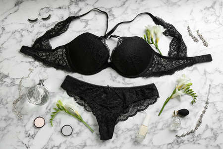 Flat lay composition with women's underwear on marble background Stock Photo