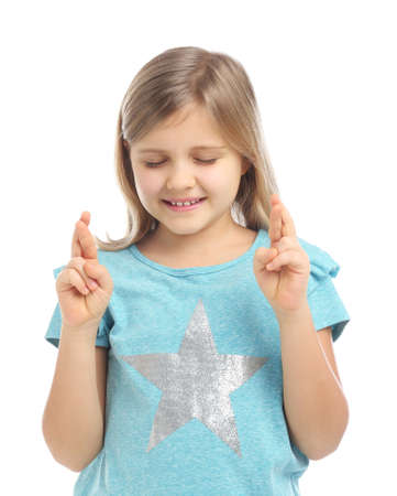 Cute little girl with crossed fingers on white background