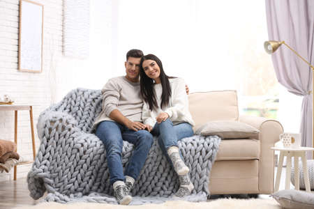Happy couple spending time together at home. Winter vacation