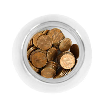 Glass jar with coins isolated on white, top view