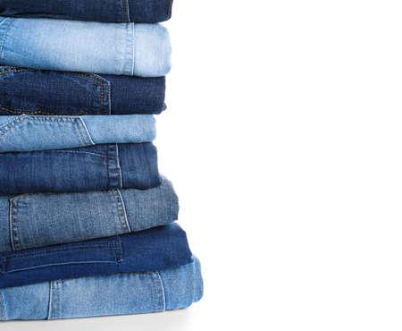 Pila di jeans diversi isolati su bianco Archivio Fotografico