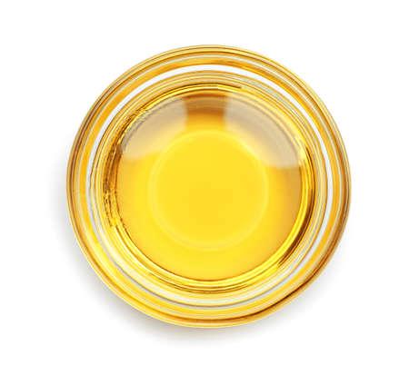 Aceite de cocina en un recipiente de vidrio aislado en blanco, vista superior