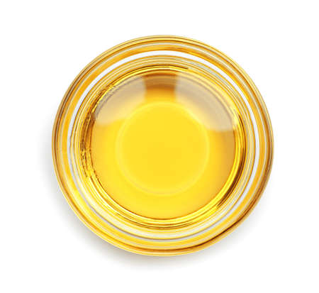 Cooking oil in glass bowl isolated on white, top view