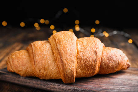 Tasty fresh croissant on wooden table, closeup Archivio Fotografico - 137787910