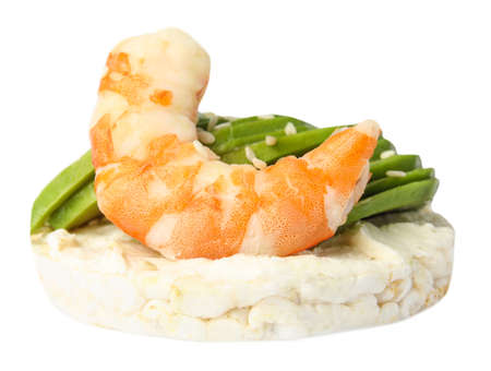 Puffed rice cake with shrimp and avocado isolated on white