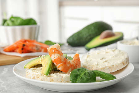 Puffed rice cake with shrimp and avocado on grey marble table indoors 写真素材 - 137789606