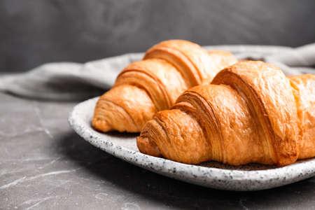 Tasty fresh croissants on brown marble table, closeup Archivio Fotografico - 137791024