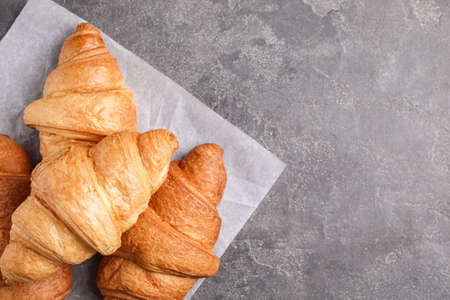 Tasty fresh croissants on grey table, flat lay. Space for text Archivio Fotografico - 137789332