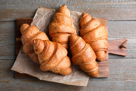 Tasty fresh croissants on wooden table, top view Archivio Fotografico - 137790972