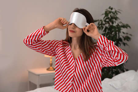 Beautiful woman wearing pajamas and sleep mask indoors. Bedtime Stok Fotoğraf - 137882217