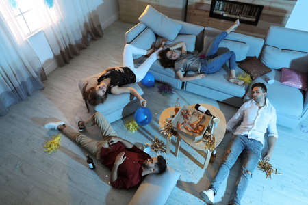 Drunk friends sleeping in messy room after party, above view Stok Fotoğraf - 137882450