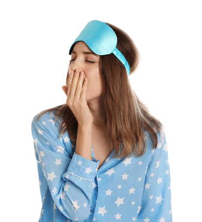Beautiful woman wearing pajamas and sleep mask on white background. Bedtime Stok Fotoğraf - 137882460