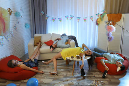Drunk friends sleeping in messy room after party Stok Fotoğraf - 137882463
