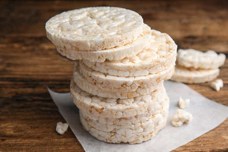 Stack of puffed rice cakes on wooden table