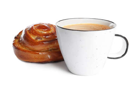 Delicious coffee and bun on white background. Sweet pastries