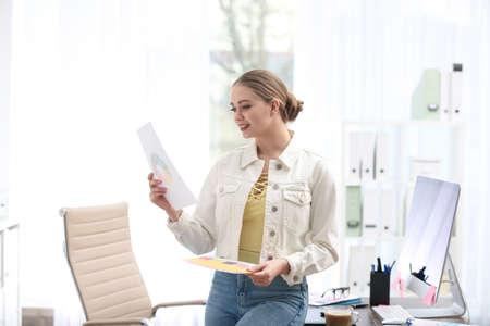 Female designer working in office. Creative profession Stock Photo