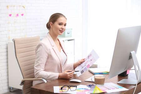 Female designer working at desk in office