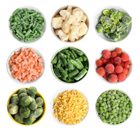 Set of different frozen vegetables on white background, top view