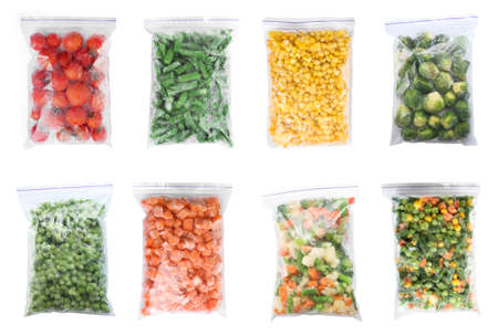 Set of different frozen vegetables in plastic bags on white background, top view