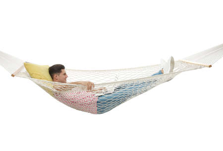 Man with laptop in hammock on white background