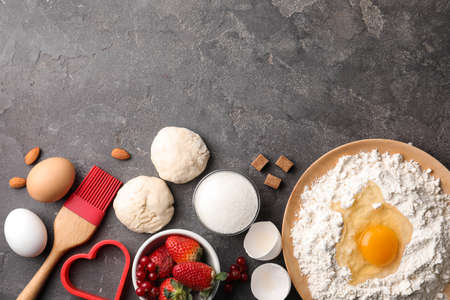 Flat lay composition with dough on grey table, space for text. Cooking pastries Stock Photo