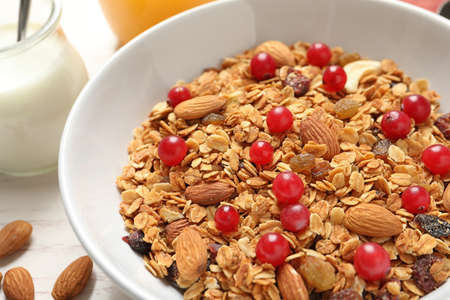 Tasty granola with cranberries on table, closeup. Healthy breakfast