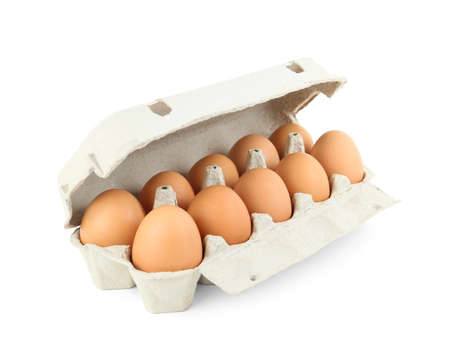 Raw chicken eggs in carton isolated on white Stock fotó