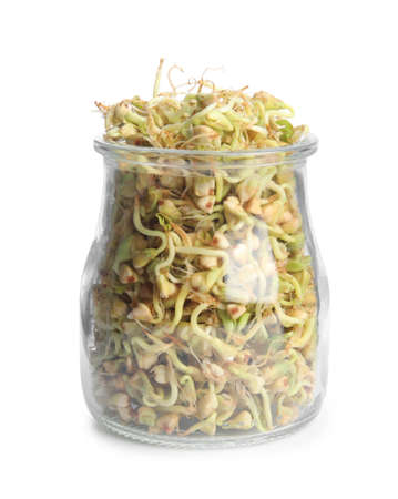 Glass jar of sprouted green buckwheat isolated on white