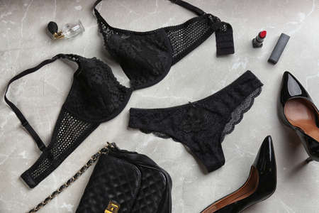 Flat lay composition with women's underwear on light grey background