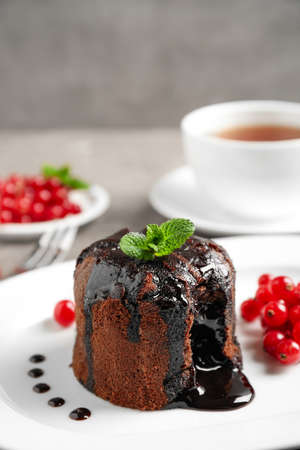 Delicious warm chocolate lava cake on plate