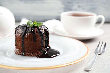 Delicious warm chocolate lava cake on grey table, closeup